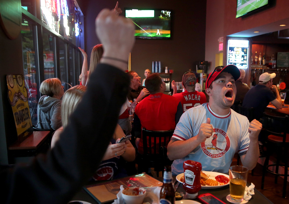 A fist pump by Bethani Hogan and the reaction by Dane Schmucker reflect  the two runs scored by the St. Louis Cardinals in the fourth inning of the National League Division Series game against the Chicago Cubs Monday, Oct. 12, 2015 at Corner Pub & Grill on West Iles Avenue.  David Spencer/The State Journal-Register