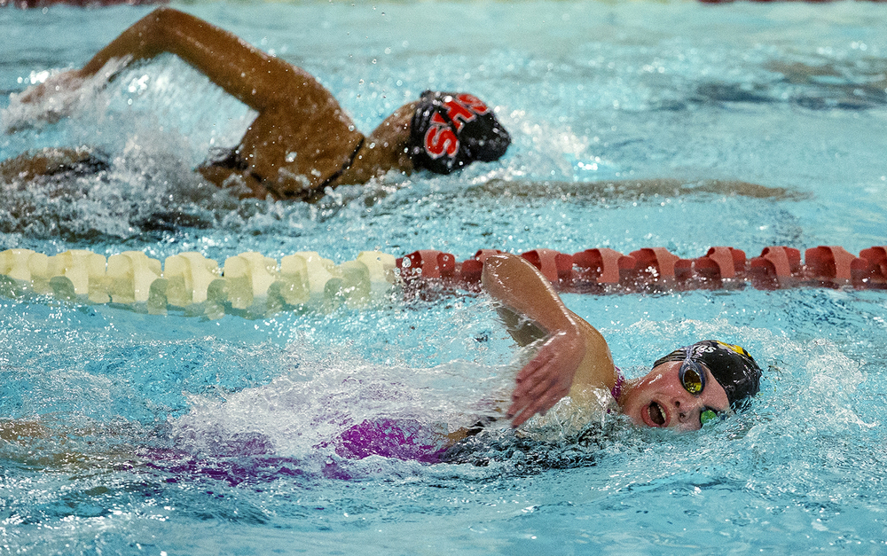 Sacred Heart-Griffin's Abby Fierstos leads Springfield's Haley Rivera in the 500 Yard Freestyle during the Springfield City Championships at Eisenhower Pool Tuesday, Oct. 20, 2015.  Ted Schurter/The State Journal-Register