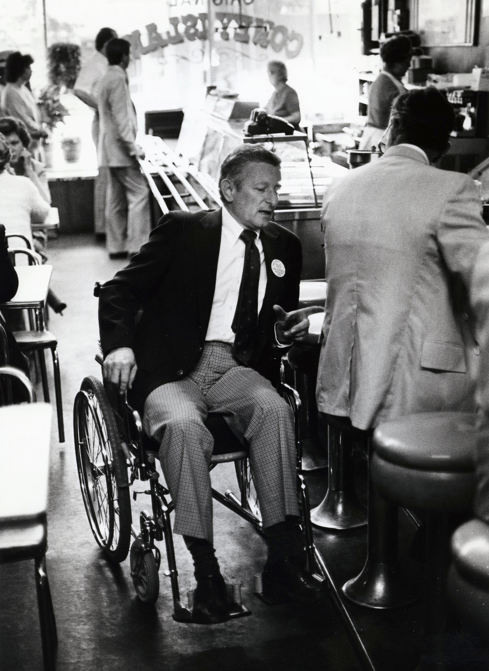 As Streets Commissioner, Ossie Langfelder used a wheelchair to illustrate the lack of handicap accessible sidewalk ramps in the downtown area, December 1981. File/The State Journal-Register