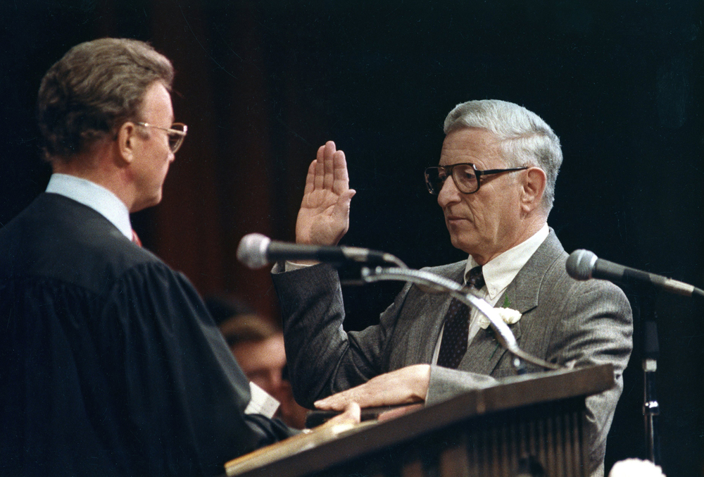 U.S. District Judge Richard Mills administers the oath of office to Springfield's new mayor, Ossie Langfelder Dec 1, 1987. File/The State Journal-Register