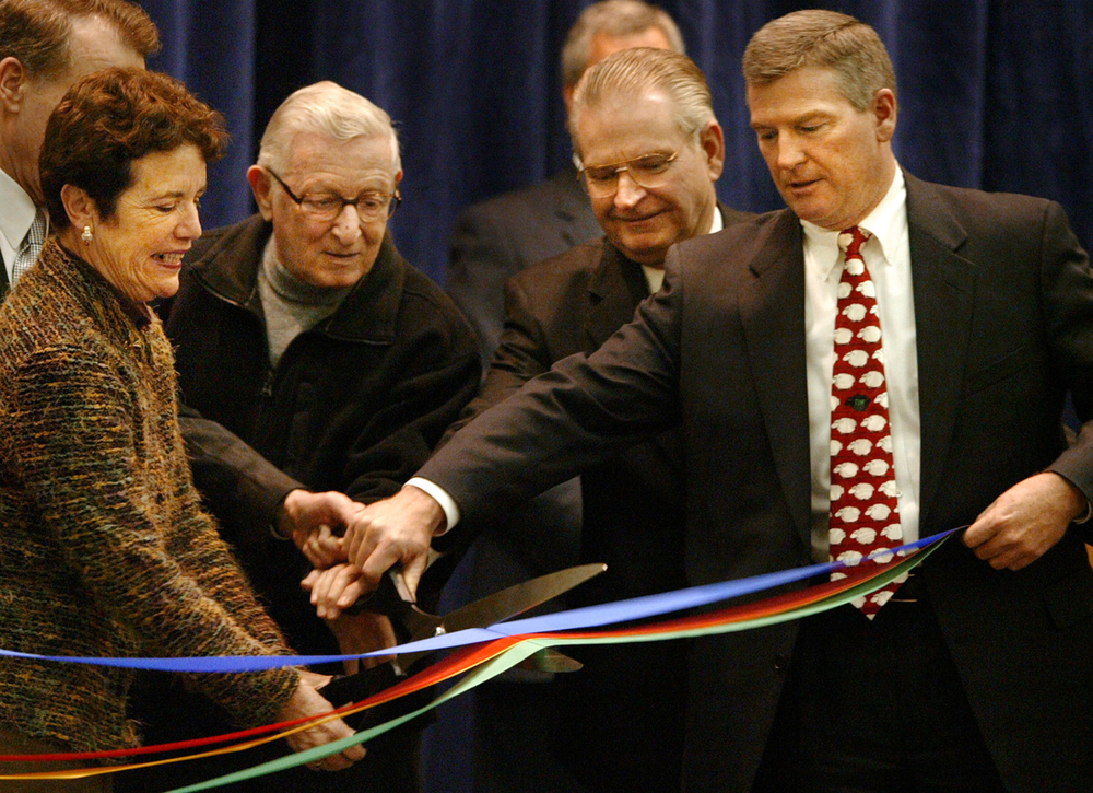 Former Springfield mayors, from left, Karen Hasara, Ossie Langfelder and Mike Houston, along with then Mayor Tim Davlin, cut a ribbon opening the Springfield Center for the Arts December 17, 2003. File/The State Journal-Register
