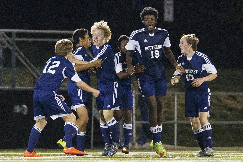 Southeast's Zach McVey is mobbed by his teammates after scoring against Sacred Heart-Griffin during the Class 2A Sacred Heart-Griffin Regional semifinals Wednesday, Oct. 21, 2015. McVey scored the game's only goal. Ted Schurter/The State Journal-Register