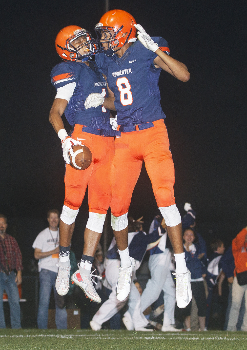 Rochester's D'ante' Cox celebrates with Collin Stallworth after his touchdown against Sacred Heart-Griffin in the first half at Rochester High School Friday, Oct. 23, 2015. Ted Schurter/The State Journal-Register