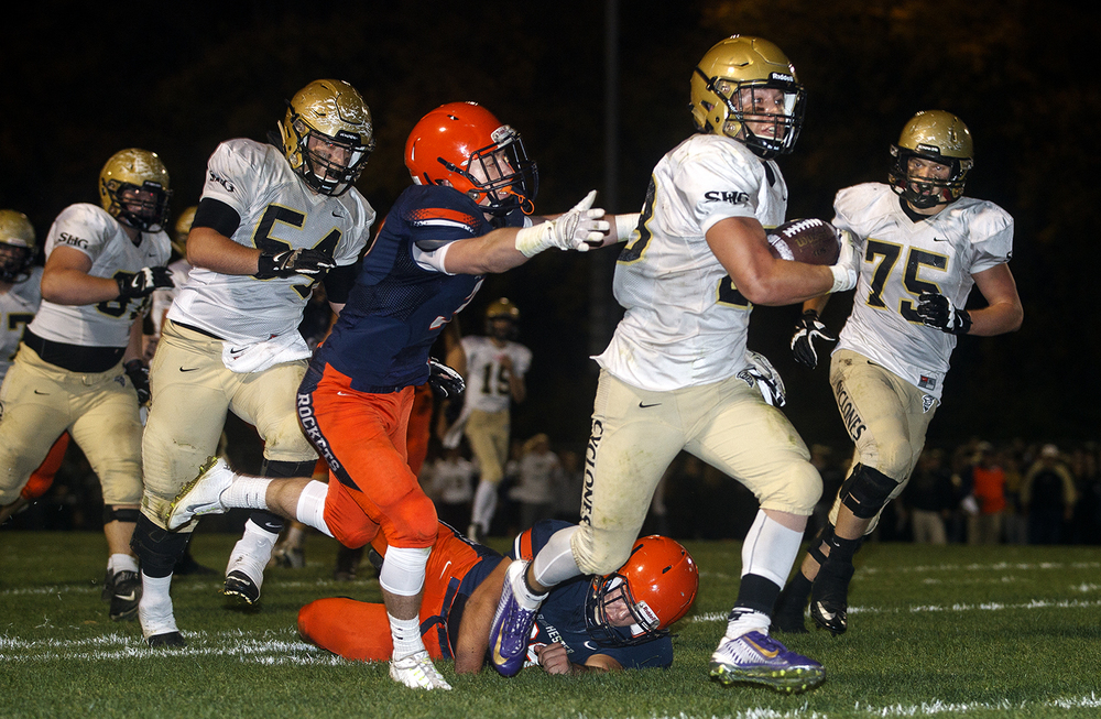 Rochester defenders can't stop Sacred Heart-Griffin's Sam Sergent as he rumbles to the endzone for a touchdown at Rochester High School Friday, Oct. 23, 2015. Ted Schurter/The State Journal-Register