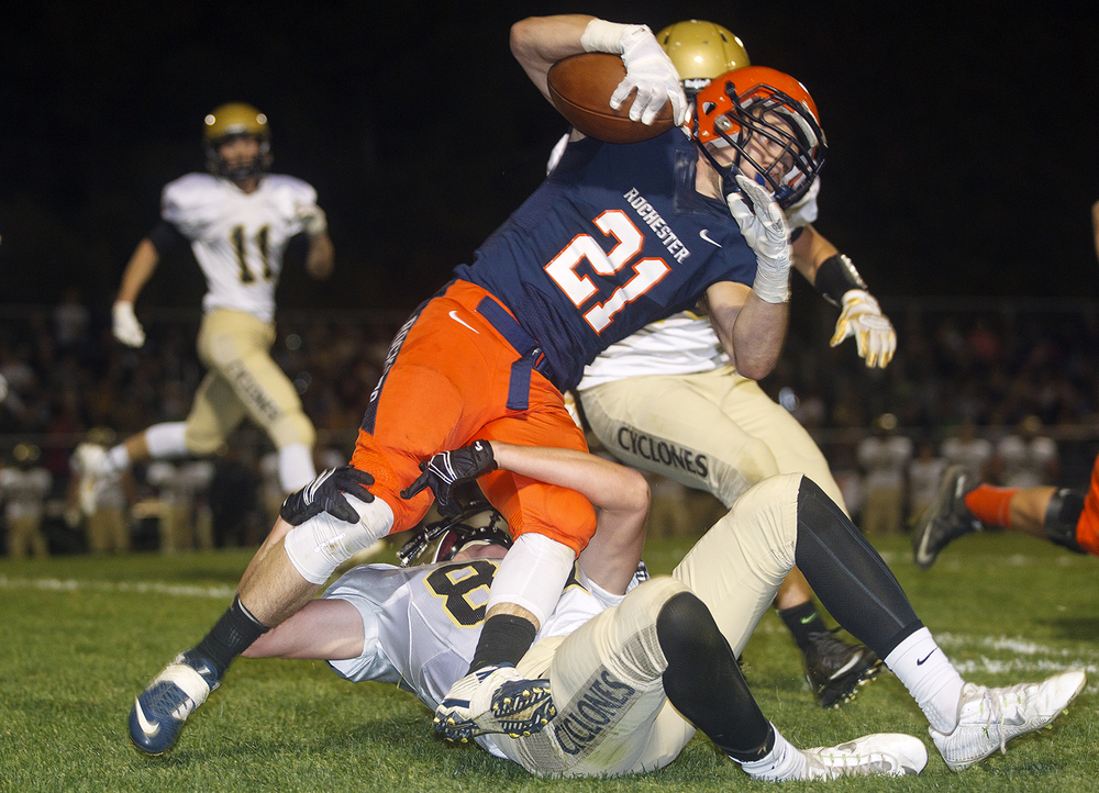 Rochester's Kenny Hedges is stopped by a Sacred Heart-Griffin defender at Rochester High School Friday, Oct. 23, 2015. Ted Schurter/The State Journal-Register