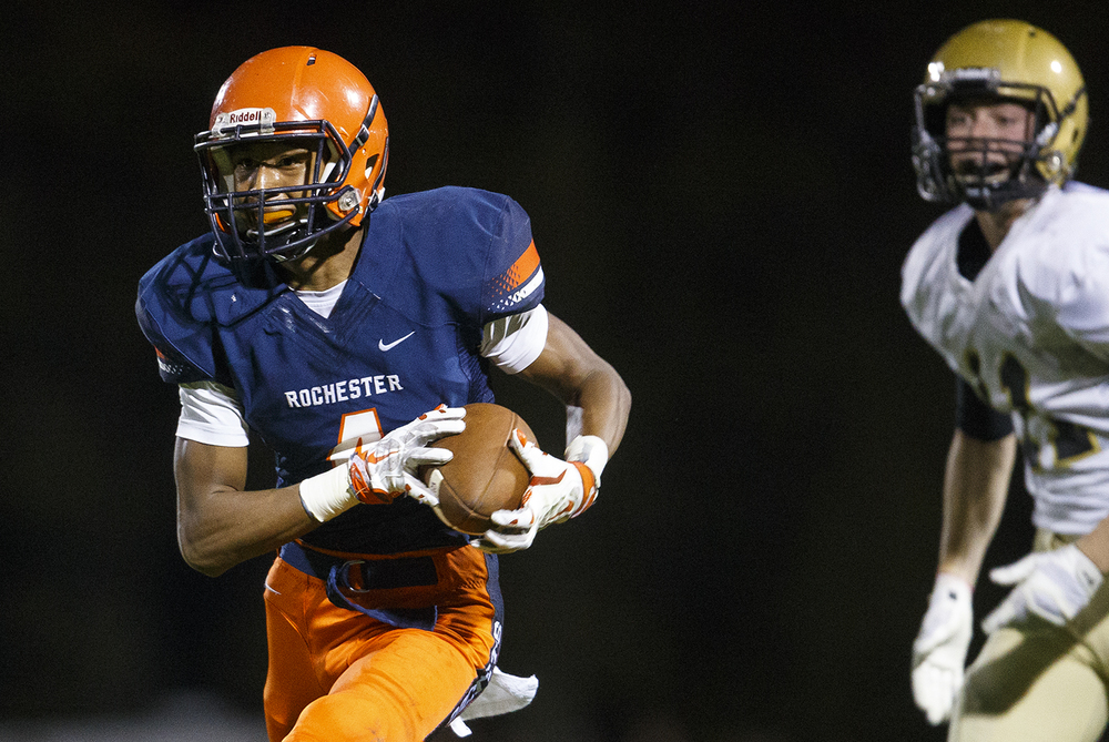 Rochester's D'ante' Cox leaves Sacred Heart-Griffin's Jack Boll behind him as he catches a pass and runs it in for a touchdown at Rochester High School Friday, Oct. 23, 2015. Ted Schurter/The State Journal-Register