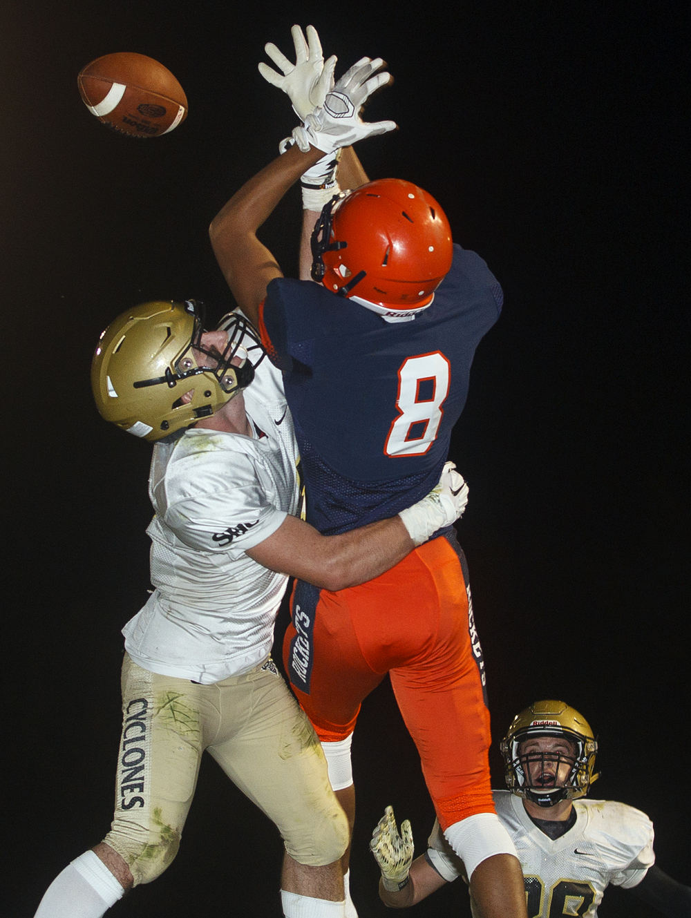 Rochester's Collin Stallworth can't grab this pass in the endzone under pressure from  Sacred Heart-Griffin's Avery Andrews  at Rochester High School Friday, Oct. 23, 2015. Ted Schurter/The State Journal-Register