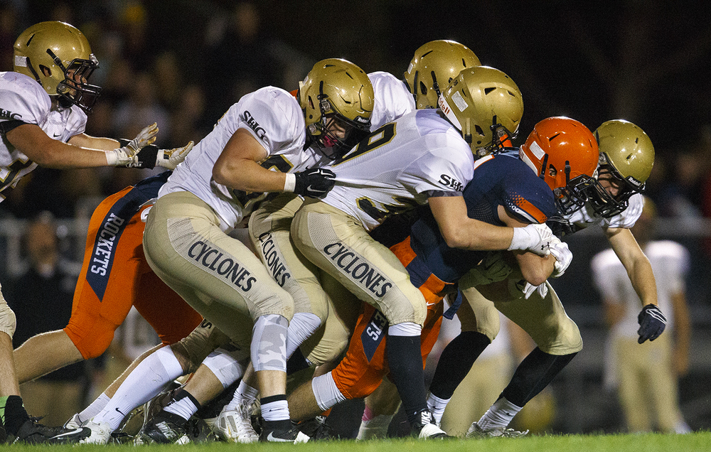 Rochester's Kenny Hedges is tackled by a gang of Sacred Heart-Griffin defenders at Rochester High School Friday, Oct. 23, 2015. Ted Schurter/The State Journal-Register