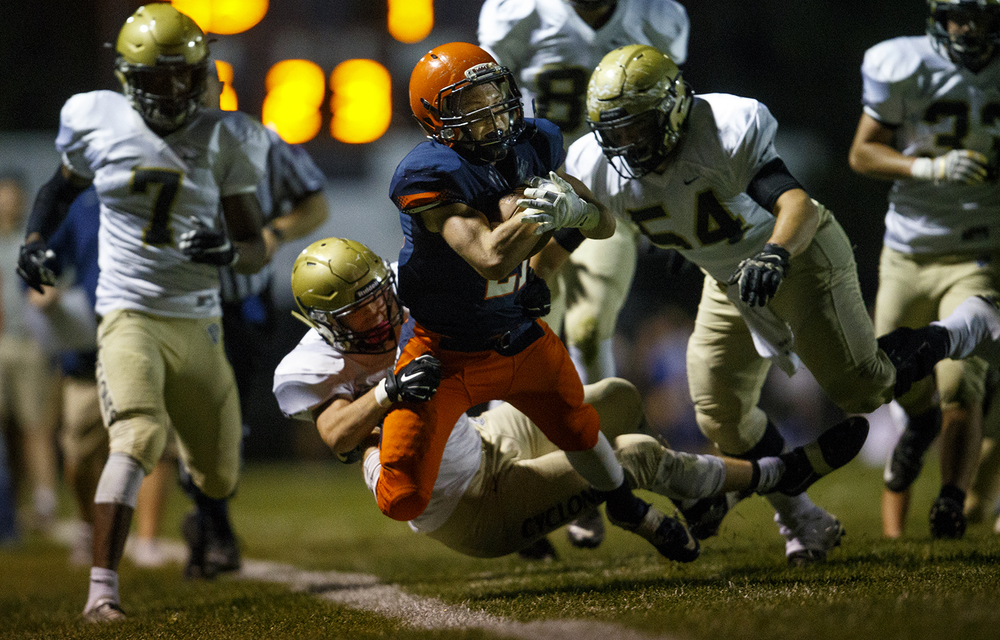 Rochester's Kenny Hedges is tackled out of bounds by Sacred Heart-Griffin defenders at Rochester High School Friday, Oct. 23, 2015. Ted Schurter/The State Journal-Register