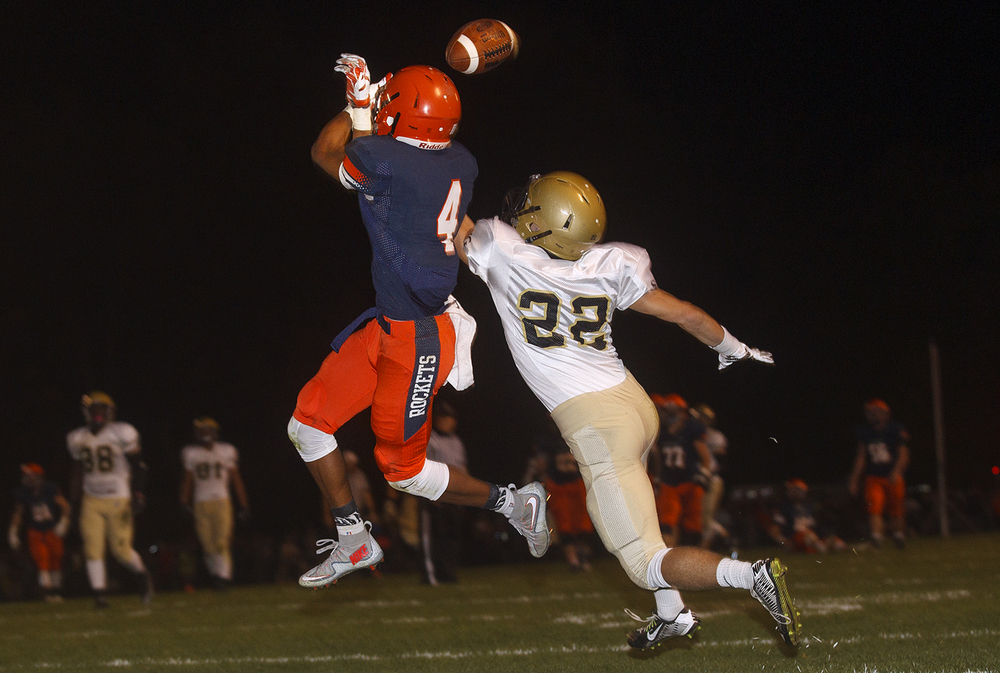 Sacred Heart-Griffin's Devin Thomas breaks up a pass intended for Rochester's D'ante' Cox at Rochester High School Friday, Oct. 23, 2015. Ted Schurter/The State Journal-Register