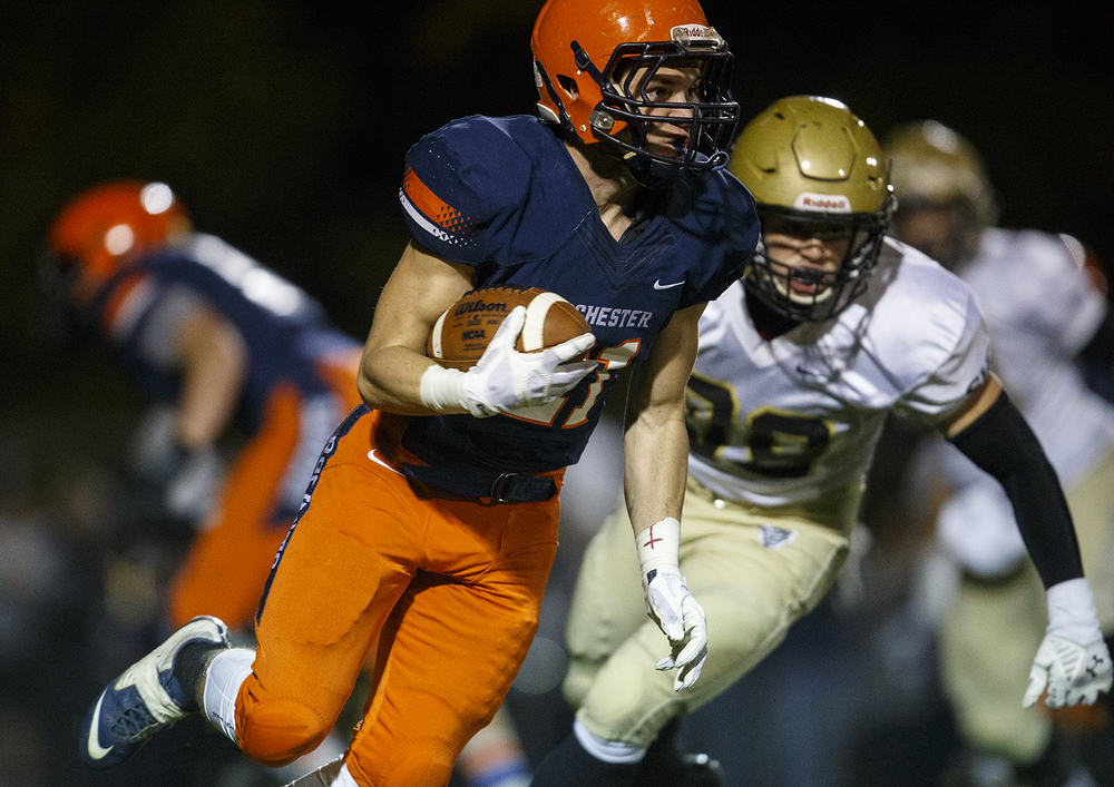 Rochester's Kenny Hedges runs the ball against Sacred Heart-Griffin at Rochester High School Friday, Oct. 23, 2015. Ted Schurter/The State Journal-Register