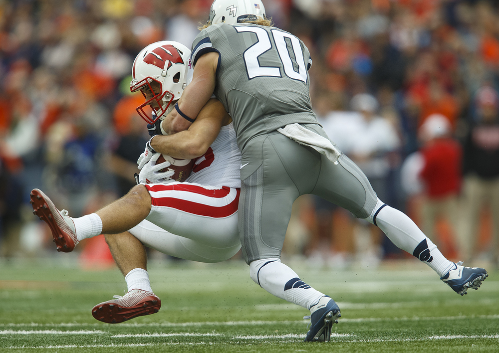 Illinois' Clayton Fejedelem tackles Wisconsin's Alex Erickson at Memorial Stadium Saturday, Oct. 24, 2015. Ted Schurter/The State Journal-Register