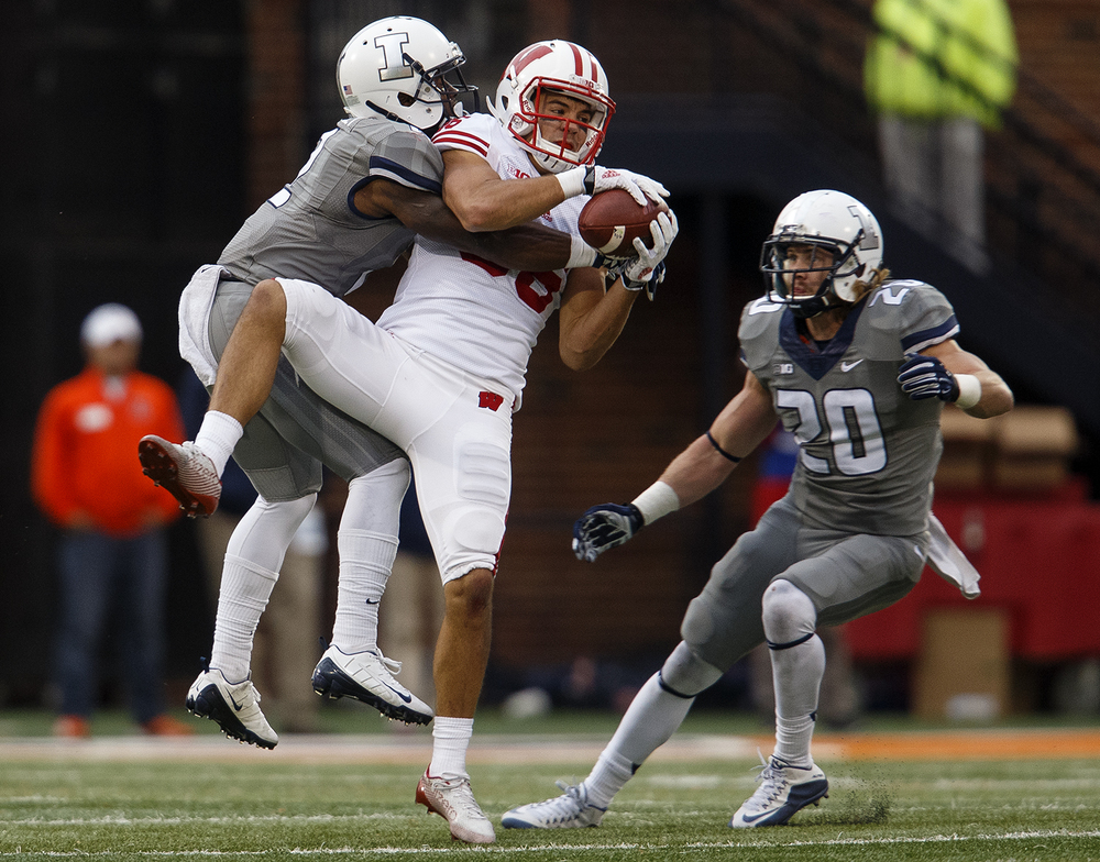 Illinois' Taylor Barton crunches Wisconsin's Alex Erickson after he made a catch at Memorial Stadium Saturday, Oct. 24, 2015. Ted Schurter/The State Journal-Register
