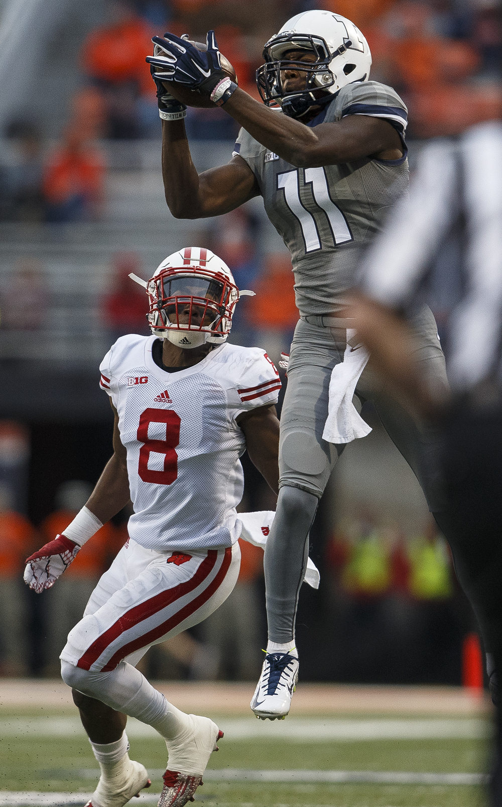 Illinois' Malik Turner grabs a pass in front of Wisconsin's Sojourn Shelton at Memorial Stadium Saturday, Oct. 24, 2015. Ted Schurter/The State Journal-Register