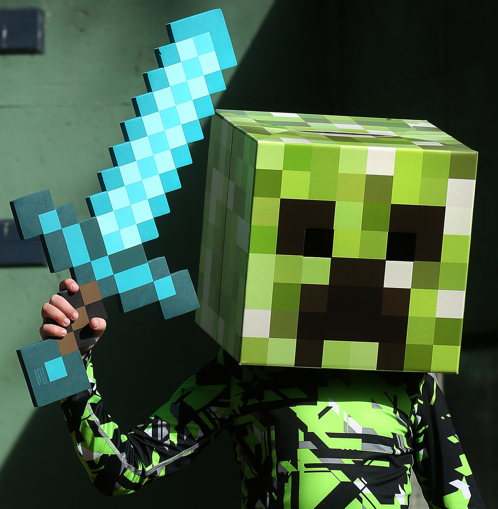 Creeper, from the video game Minecraft, is Braden Lueking, 7, of Springfield. While striking a pose with his trusty sword, Braden said he chose his costume because he loved to play Minecraft. David Spencer/The State Journal-Register