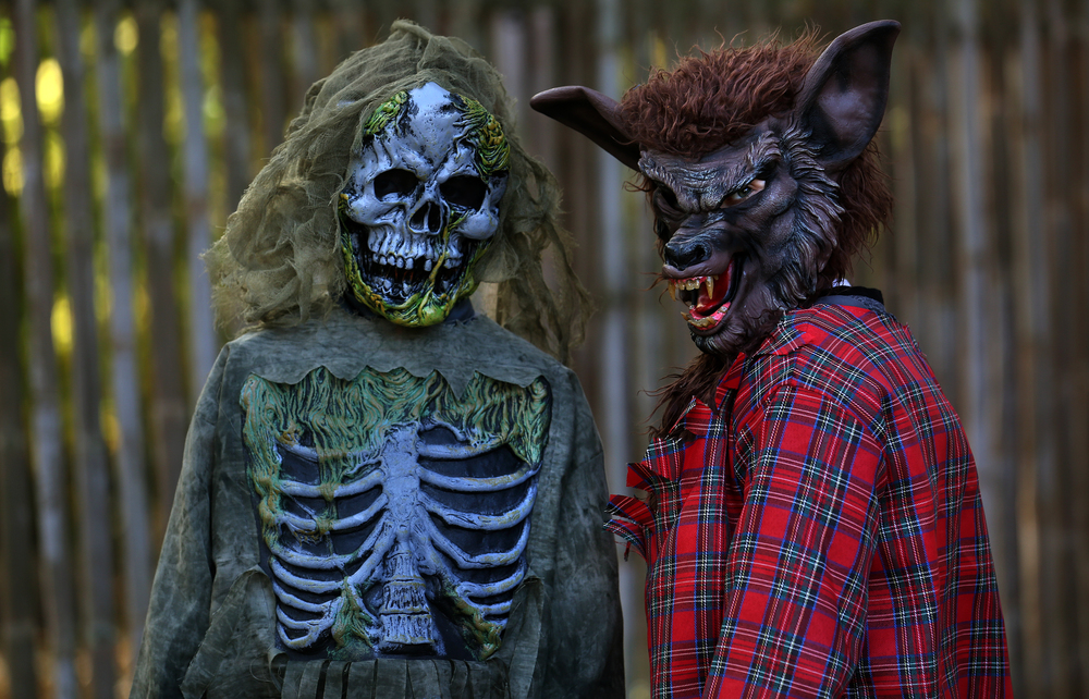 Said to be good friends, really, are Tyler Putnam, 8, of Fancy Prairie, left who was a Zombie skeleton, and Elias Hurley, 7, of Fancy Prairie who does his best werewolf impression. David Spencer/The State Journal-Register