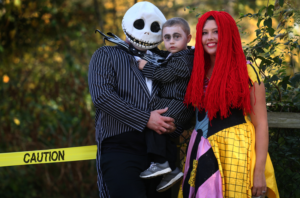 "The Jack Skellington family, from the movie ""The Nightmare Before Christmas,"" takes time out for a portrait. Jack is Mike Walsh who holds son Declan Walsh, 2. Mom Nina Davis, aka Sally in the movie, rounds out the family. David Spencer/The State Journal-Register"
