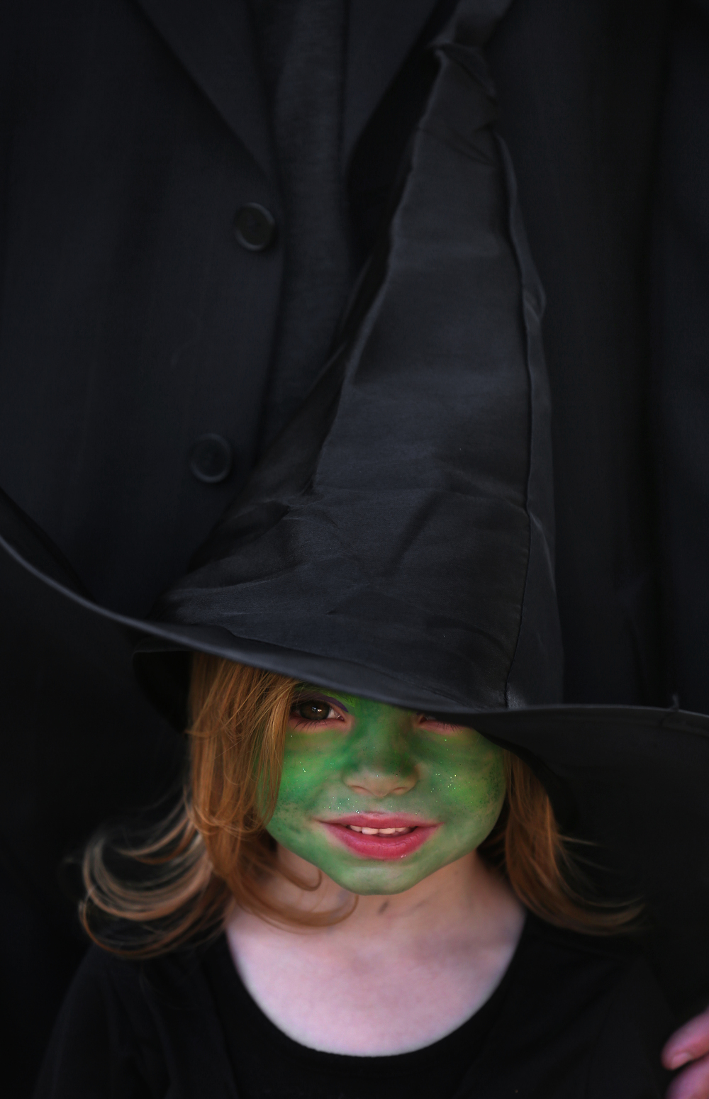 Even with luminous green makeup, 5-year-old Sophia Stark of Pawnee insisted folks know she was a good witch. David Spencer/The State Journal-Register