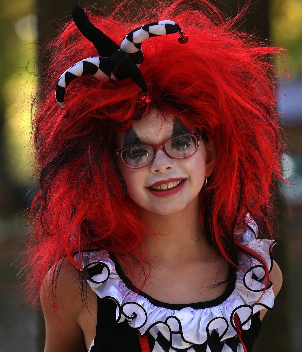 Saying she wanted to be scary and cute at the same time is Kyah McClintock, 9, of Chatham, who was dressed Sunday as a Harlequin. David Spencer/The State Journal-Register