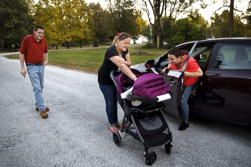 Shelby Williams shows her newborn baby daughter Jordan Rees to her aunt, Erica Ragan, who stopped as she passed Williams and her fiancé Jamison Reese while they were walking in Dawson Wednesday, Oct. 14, 2015. Ted Schurter/The State Journal-Register