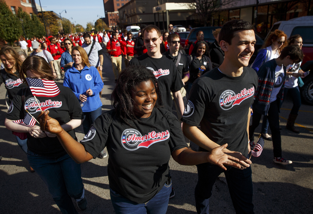 Monee Yancey and Michael Barth and hundreds of other volunteers march to the Old State to pledge their continuing commitment to their communities during the 21st Annual Illinois' National Service Recognition Day Wednesday, Oct. 21, 2015. Ted Schurter/The State Journal-Register
