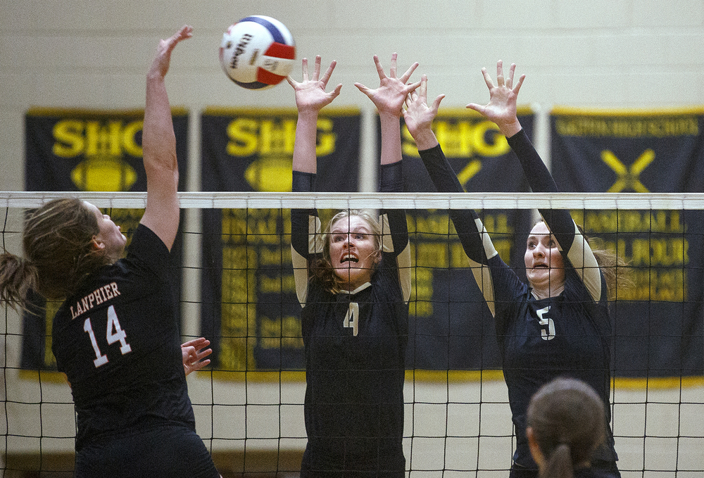 Lanphier's Chloe Bellot spikes the ball toward Sacred Heart-Griffin's Delaney Jordan and Elise Cummins during the 3A Sacred Heart-Griffin Regional volleyball at Belz Gym Tuesday Oct. 27, 2015. Ted Schurter/The State Journal-Register