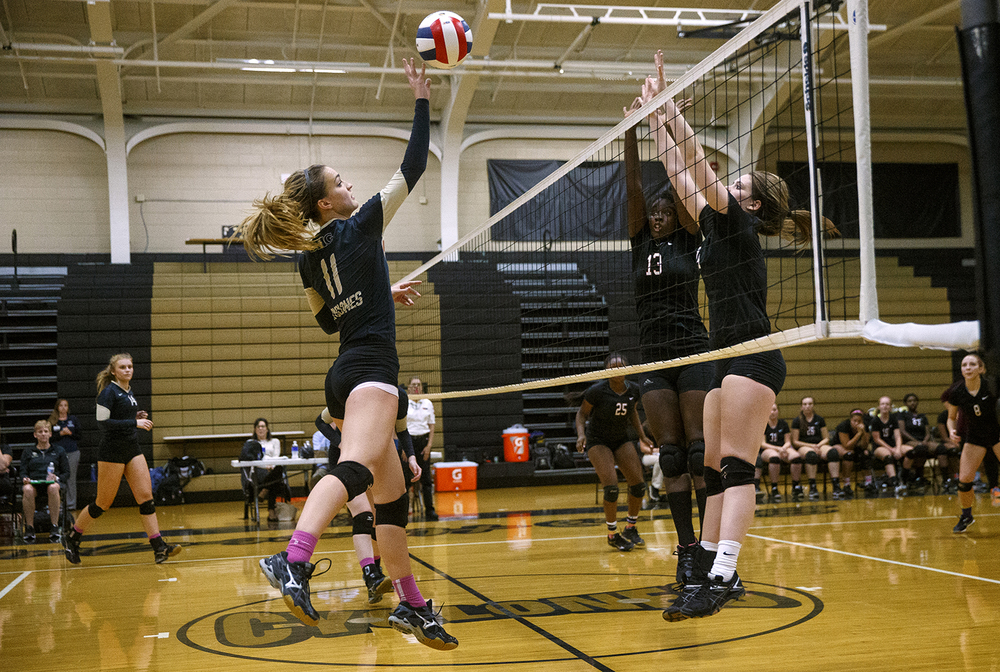 Sacred Heart-Griffin's  Emma Hopkins tips the ball toward Lanphier during the 3A Sacred Heart-Griffin Regional volleyball at Belz Gym Tuesday Oct. 27, 2015. Ted Schurter/The State Journal-Register