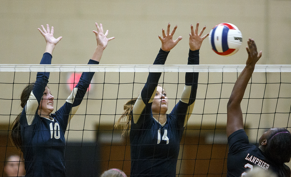Sacred Heart-Griffin's Megan Lewis, left, and Annie Urbance block a spike by Lanphier's Correan Young during the 3A Sacred Heart-Griffin Regional volleyball at Belz Gym Tuesday Oct. 27, 2015. Ted Schurter/The State Journal-Register