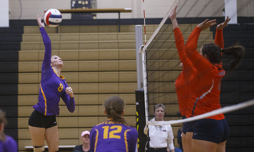 Taylorville's Payton Tucker spikes the ball against Rochester during the 3A Sacred Heart-Griffin Regional volleyball at Belz Gym Tuesday Oct. 27, 2015. Ted Schurter/The State Journal-Register