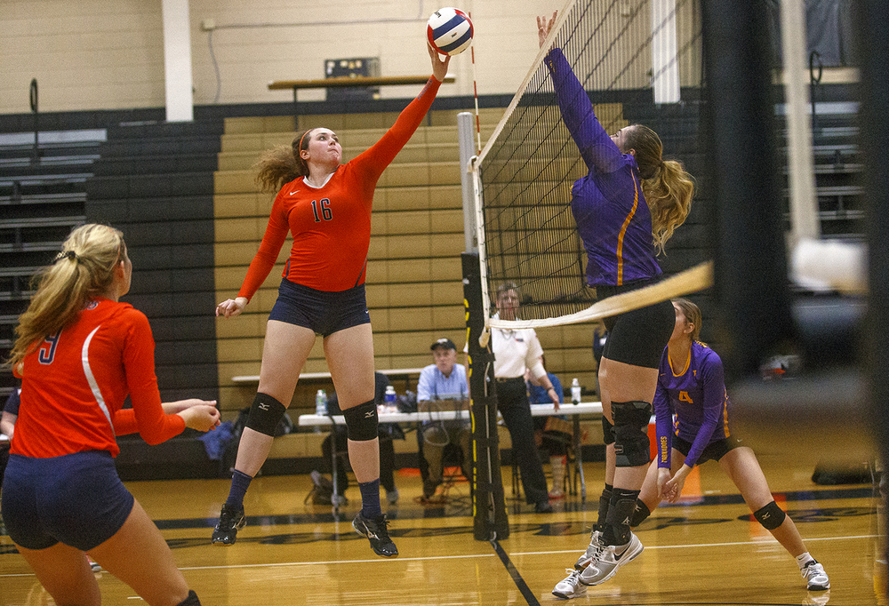 Rochester's Angela Perry tips the ball toward Taylorville during the 3A Sacred Heart-Griffin Regional volleyball at Belz Gym Tuesday Oct. 27, 2015. Ted Schurter/The State Journal-Register