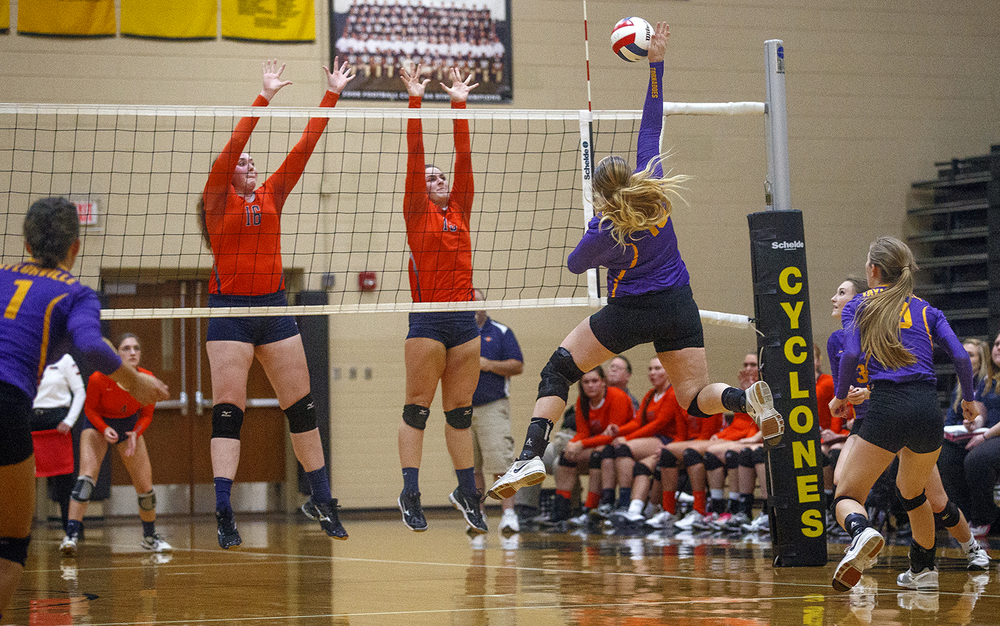 Taylorville's Makala Finks spikes the ball toward Rochester during the 3A Sacred Heart-Griffin Regional volleyball at Belz Gym Tuesday Oct. 27, 2015. Ted Schurter/The State Journal-Register