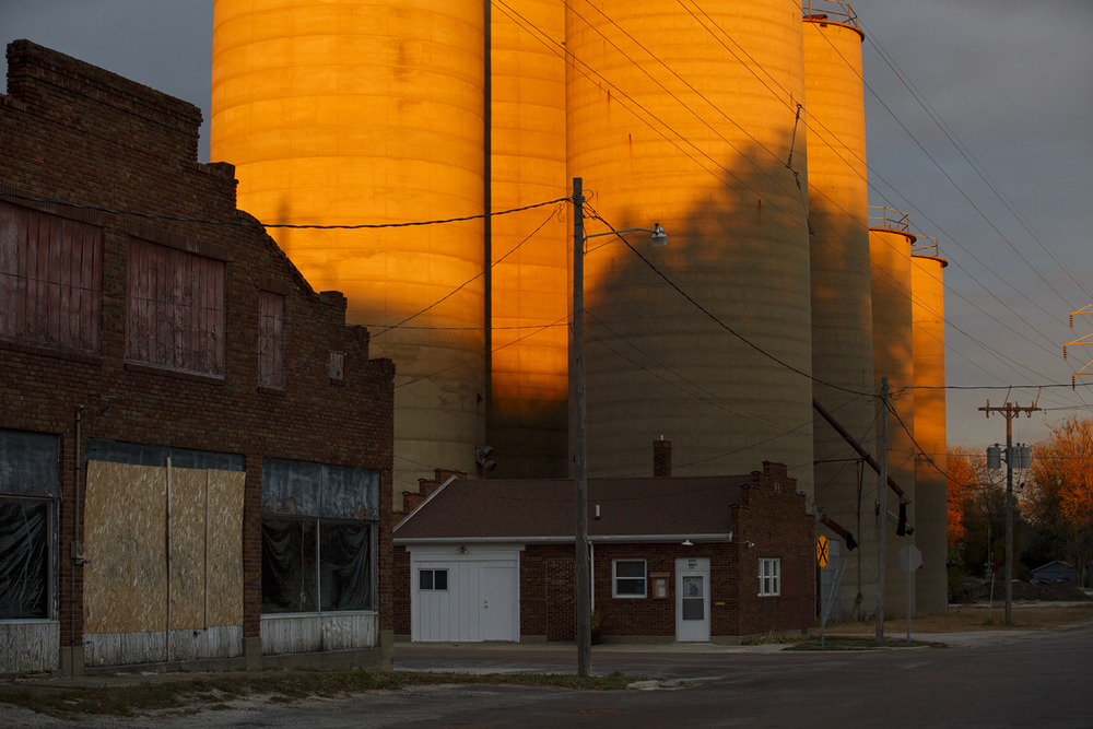 The sun breaks through a layer of overcast clouds to cast a brilliant glow on grain silos in Illiopolis Oct. 29, 2015. Rich Saal/The State Journal-Register