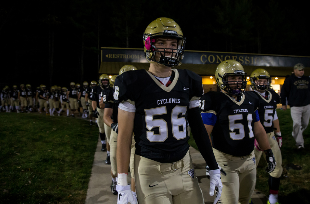 Sacred Heart-Griffin's Lance Winkler (56) and Tommy Johnston (51) walk out with the team prior to taking on Palos Heights Shepard in the first round of the Class 6A playoffs at the Sacred Heart-Griffin Sports Complex, Friday, Oct. 30, 2015, in Springfield, Ill. Justin L. Fowler/The State Journal-Register