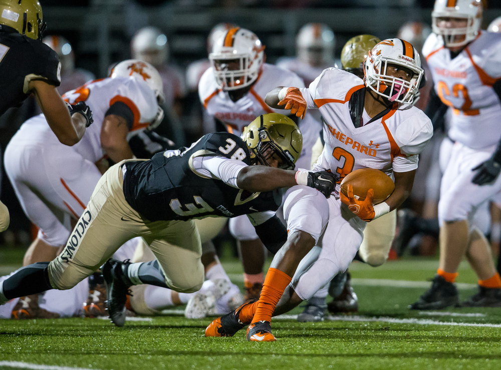 Sacred Heart-Griffin's DJ Mackey (38) brings down Palos Heights Shepard's Demetrius Harrison (3) on a run in the first quarter during the first round of the Class 6A playoffs at the Sacred Heart-Griffin Sports Complex, Friday, Oct. 30, 2015, in Springfield, Ill. Justin L. Fowler/The State Journal-Register