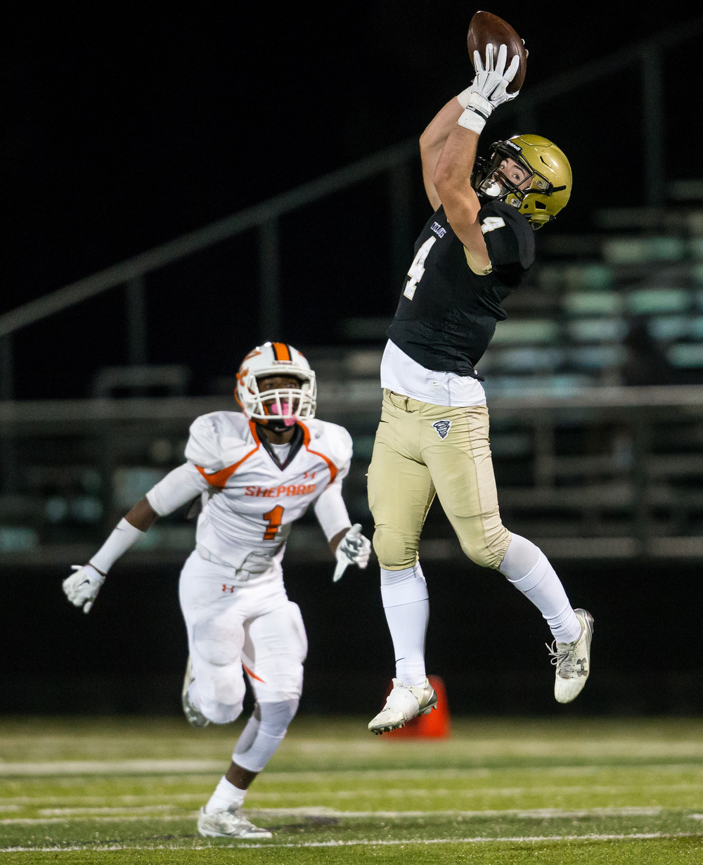 Sacred Heart-Griffin's Sam Bonansinga (4) leaps up to make a catch against Palos Heights Shepard's Mario Wilson (1) in the second quarter during the first round of the Class 6A playoffs at the Sacred Heart-Griffin Sports Complex, Friday, Oct. 30, 2015, in Springfield, Ill. Justin L. Fowler/The State Journal-Register