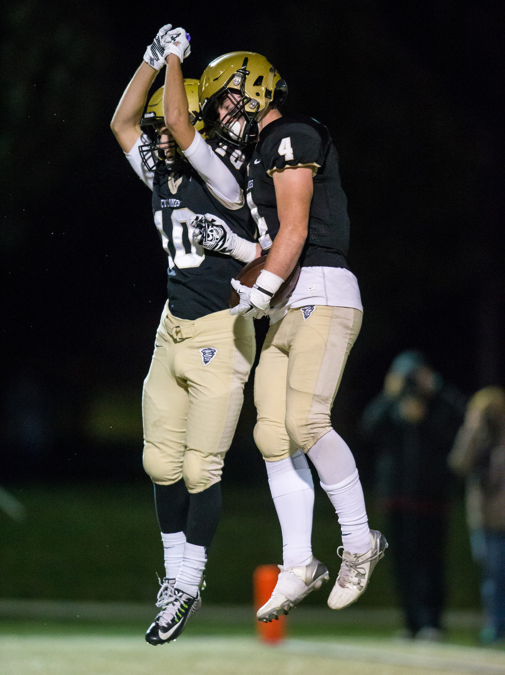 Sacred Heart-Griffin's Sam Bonansinga (4) celebrates his touchdown with Jake Reid (10) against Palos Heights Shepard in the second quarter during the first round of the Class 6A playoffs at the Sacred Heart-Griffin Sports Complex, Friday, Oct. 30, 2015, in Springfield, Ill. Justin L. Fowler/The State Journal-Register