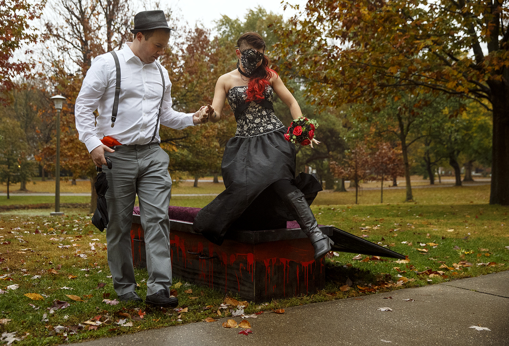 Carlos Beard helps his sister Amanda Jones out of her casket before escorting her down the aisle to be married to Jake Bryant during a Halloween day wedding at the gazebo at Washington Park Saturday, October 31, 2015. Ted Schurter/The State Journal-Register