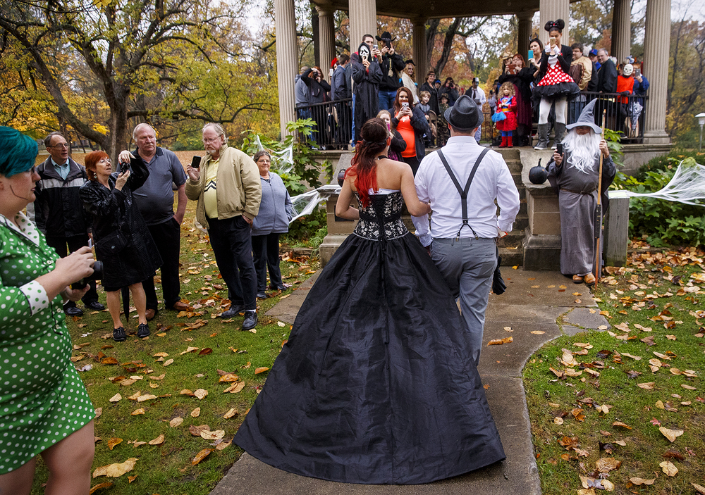 Carlos Beard escorts his sister Amanda Jones down the aisle to be married to Jake Bryant during a Halloween day wedding at the gazebo at Washington Park Saturday, October 31, 2015. Ted Schurter/The State Journal-Register