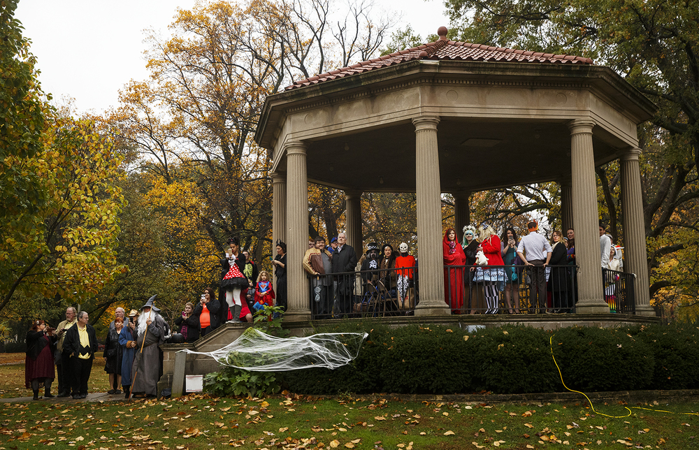 Guests at Jake Bryant and Amanda Jones' Halloween day wedding, many wearing their own costumes, watch as the wedding party pushes the bride's casket toward the ceremony Saturday, Oct. 31, 2015. Ted Schurter/The State Journal-Register