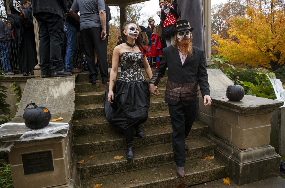 Jake Bryant and Amanda Jones leave the gazebo at Washington Park as husband and wife after their Halloween day wedding ceremony Saturday, Oct. 31, 2015. Ted Schurter/The State Journal-Register