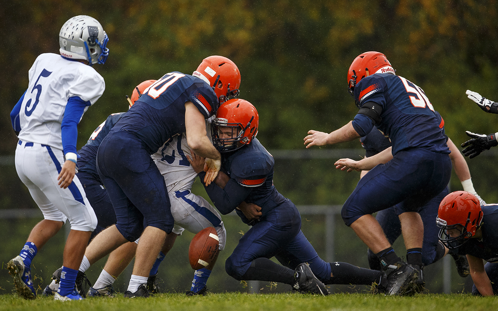 The Rochester defense forces an Alton Marquette fumble in the first half in the first round of the Class 4A football playoffs at Rocket Booster Stadium Saturday, Oct. 31, 2015.  Ted Schurter/The State Journal-Register