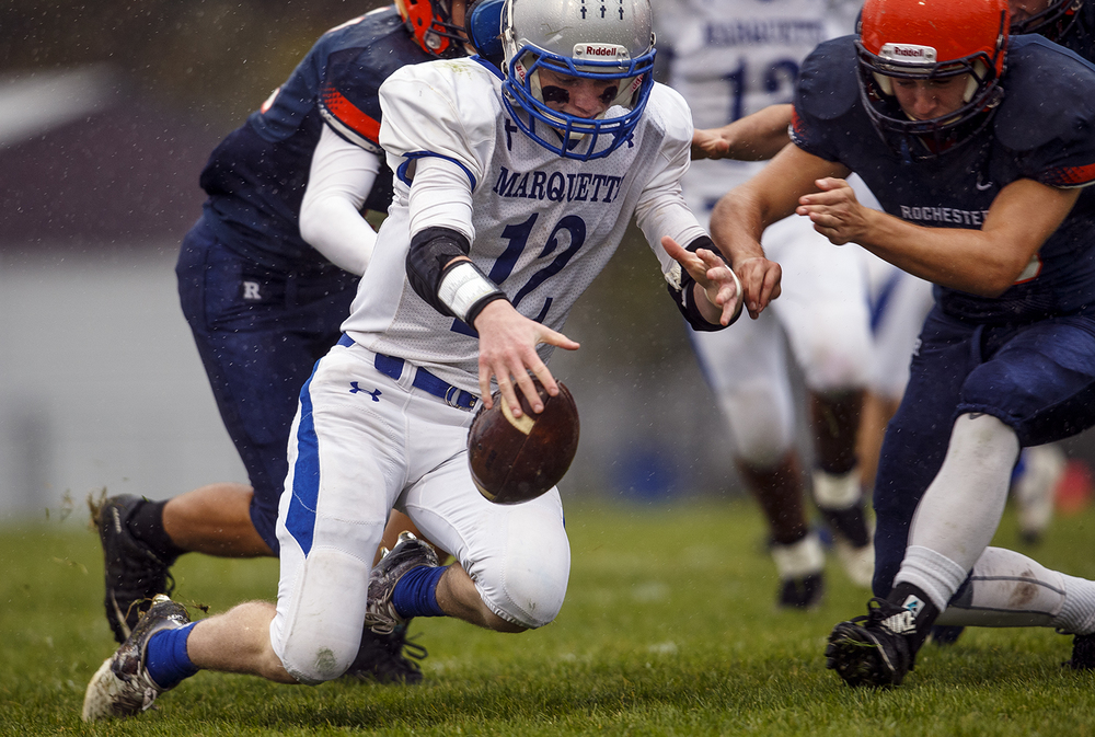 Alton Marquette's Brady Mcafee corrals the opening on-sides kick against Rochester in the first round of the Class 4A football playoffs at Rocket Booster Stadium Saturday, Oct. 31, 2015.  Ted Schurter/The State Journal-Register