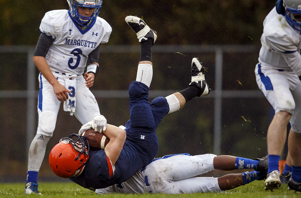 Rochester's Kenny Hedges tumbles into the endzone for one of his five first-half touchdowns against Alton Marquette in the first round of the Class 4A football playoffs at Rocket Booster Stadium Saturday, Oct. 31, 2015.  Ted Schurter/The State Journal-Register