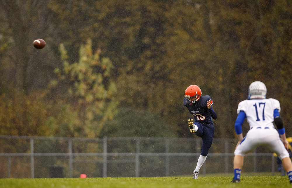 Rochester's Ryan Richards kicks off to Alton Marquette in the first round of the Class 4A football playoffs at Rocket Booster Stadium Saturday, Oct. 31, 2015.  Ted Schurter/The State Journal-Register