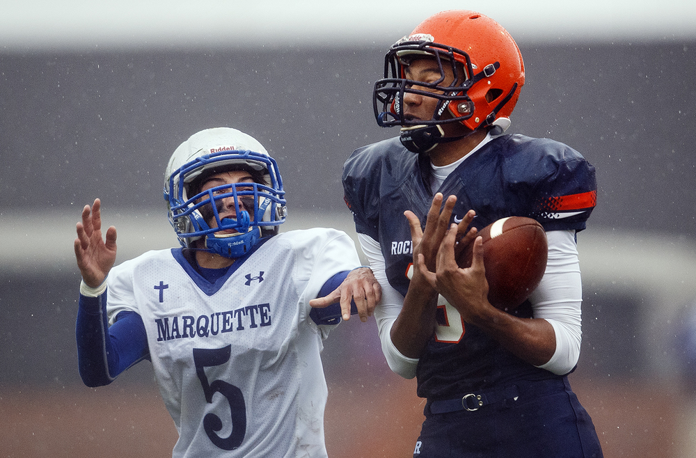 Rochester's Collin Stallworth holds onto this first half pass in front of Alton Marquette's Jeremy Strebel in the first round of the Class 4A football playoffs at Rocket Booster Stadium Saturday, Oct. 31, 2015.  Ted Schurter/The State Journal-Register