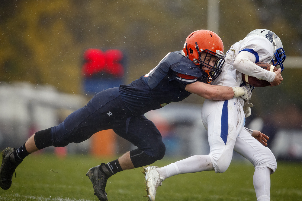 Rochester's  Christian Lett wraps up Alton Marquette's Brian Nagy in the first round of the Class 4A football playoffs at Rocket Booster Stadium Saturday, Oct. 31, 2015.  Ted Schurter/The State Journal-Register