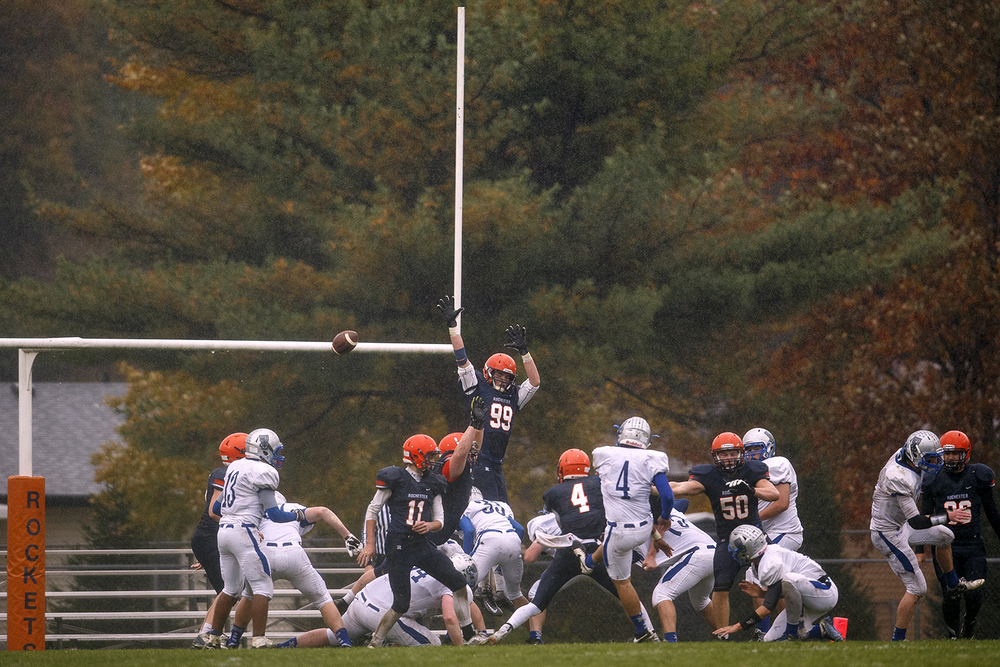 Alton Marquette's Liam Maher attempts an extra point against Rochester in the first round of the Class 4A football playoffs at Rocket Booster Stadium Saturday, Oct. 31, 2015. Ted Schurter/The State Journal-Register