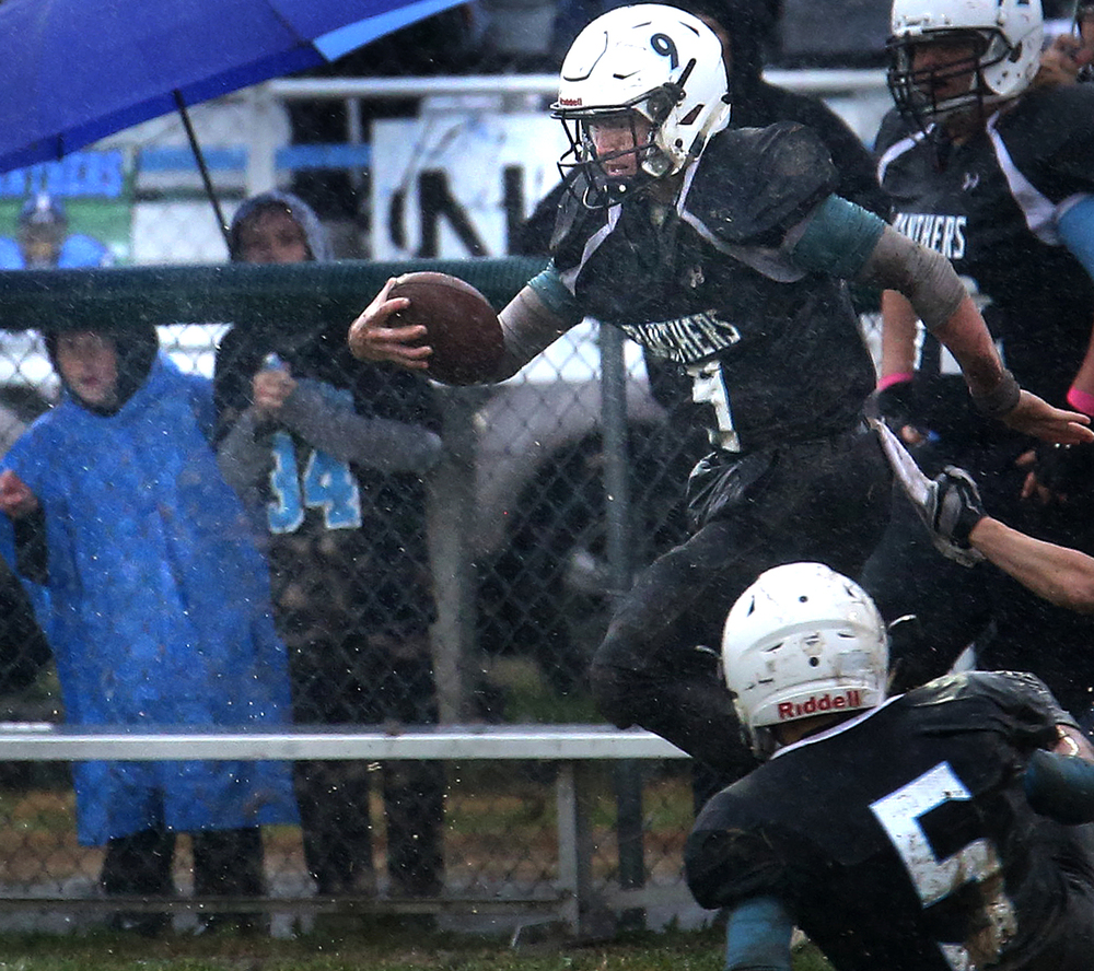 North Mac quarterback Brennan White sprints for a long run late in the fourth quarter which set up the Panther's go-ahead touchdown shortly later. David Spencer/The State Journal-Register