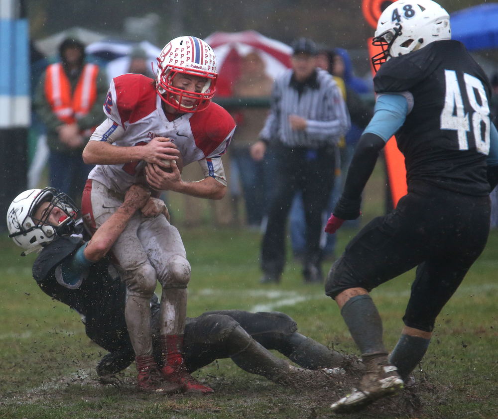 North Mac defender Jesse Trew puts the pressure on Cardinals ball carrier Daulton Nibbe late in the fourth quarter. David Spencer/The State Journal-Register