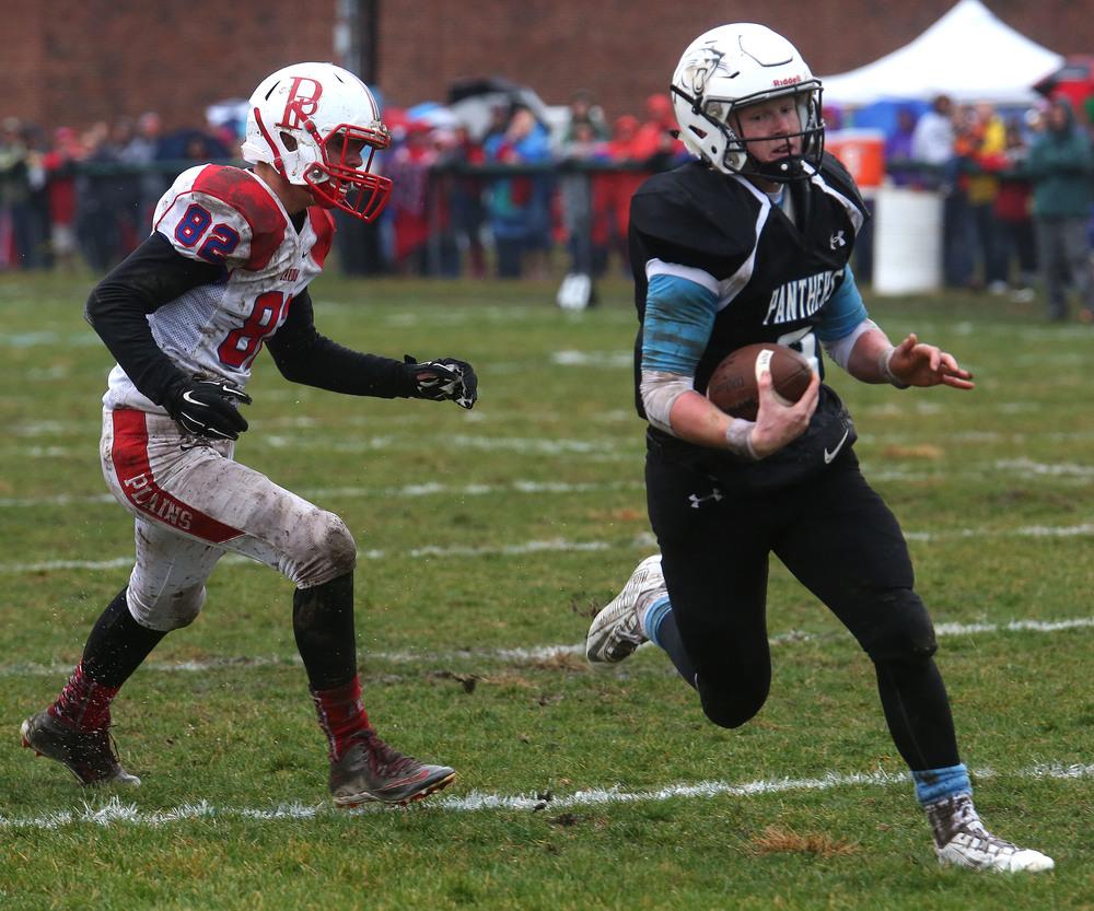 North Mac quarterback Brennan White runs for his team's first touchdown Saturday. David Spencer/The State Journal-Register